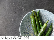Купить «close up of green chili peppers in bowl», фото № 32421140, снято 12 апреля 2018 г. (c) Syda Productions / Фотобанк Лори