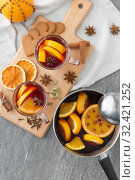 Купить «pot with hot mulled wine, orange slices and spices», фото № 32421252, снято 4 октября 2018 г. (c) Syda Productions / Фотобанк Лори