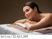 Купить «young woman lying at spa or massage parlor», фото № 32421260, снято 13 октября 2019 г. (c) Syda Productions / Фотобанк Лори