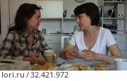Купить «Portrait of young woman talking with mature woman, with cup of coffee at table», видеоролик № 32421972, снято 27 мая 2019 г. (c) Яков Филимонов / Фотобанк Лори