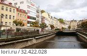 Купить «Scenic view of Tepla river embankment in spa town of Karlovy Vary on rainy autumn day», видеоролик № 32422028, снято 10 октября 2019 г. (c) Яков Филимонов / Фотобанк Лори