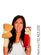 Купить «Eine junge Frau ärgert sich, dass sie den Hausputz machen muss.», фото № 32423232, снято 23 февраля 2020 г. (c) age Fotostock / Фотобанк Лори