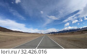 Купить «Driving along mountain road Chuysky Tract along Kurai Ridge on Altai at Spring season», видеоролик № 32426016, снято 16 июля 2019 г. (c) Serg Zastavkin / Фотобанк Лори
