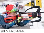 Купить «Sportswoman biathlete Yegorova Polina Kazakhstan rifle shooting prone position», фото № 32426096, снято 12 апреля 2019 г. (c) А. А. Пирагис / Фотобанк Лори