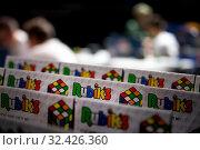 Купить «Крупным планом коробки с головоломкой кубик Рубика во время российского отборочного этапа Red Bull Rubik's Cube 2019  в городе Москве, Россия, 16 ноября 2019», фото № 32426360, снято 16 ноября 2019 г. (c) Николай Винокуров / Фотобанк Лори