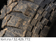 Купить «Old used rubber extreme terrain tire with worn wear-resistant tread. Close-up of black muddy off-road tire on 4x4 automobile», фото № 32426772, снято 12 сентября 2019 г. (c) А. А. Пирагис / Фотобанк Лори