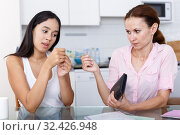 Купить «Girl asks cash», фото № 32426948, снято 9 июля 2018 г. (c) Яков Филимонов / Фотобанк Лори