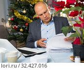 Купить «Concerned man working with laptop», фото № 32427016, снято 10 января 2019 г. (c) Яков Филимонов / Фотобанк Лори