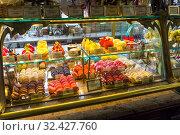 Купить «Прилавок со сладостями и пирожными в магазине купцов Елисеевых. Санкт-Петербург, Россия», фото № 32427760, снято 16 июня 2019 г. (c) Сергей Рыбин / Фотобанк Лори