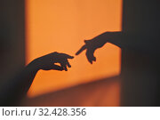 Купить «Abstract shadow silhouette of gesture touch by humans palms from sunbeam on wall», фото № 32428356, снято 7 мая 2019 г. (c) Kira_Yan / Фотобанк Лори