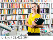 Купить «Woman taking literature books in store», фото № 32428564, снято 22 ноября 2019 г. (c) Яков Филимонов / Фотобанк Лори