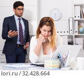 Купить «Stressed businesswoman with dissatisfied colleague», фото № 32428664, снято 1 июня 2017 г. (c) Яков Филимонов / Фотобанк Лори
