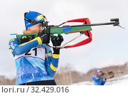 Купить «Sportswoman biathlete Kryukova Arina (Kazakhstan) rifle shooting in standing position. Biathlete in shooting range», фото № 32429016, снято 12 апреля 2019 г. (c) А. А. Пирагис / Фотобанк Лори