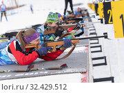 Kamchatka sportswoman biathlete Valentina Vakhrusheva rifle shooting in prone position. Biathlete in shooting range (2019 год). Редакционное фото, фотограф А. А. Пирагис / Фотобанк Лори