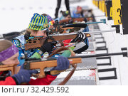 Купить «Sportswoman's biathlete rifle shooting in prone position. Group of biathletes in shooting range», фото № 32429592, снято 12 апреля 2019 г. (c) А. А. Пирагис / Фотобанк Лори