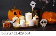 Купить «pumpkins, candles and halloween decorations», видеоролик № 32429664, снято 14 ноября 2019 г. (c) Syda Productions / Фотобанк Лори