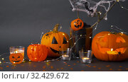 Купить «pumpkins, candles and halloween decorations», видеоролик № 32429672, снято 14 ноября 2019 г. (c) Syda Productions / Фотобанк Лори
