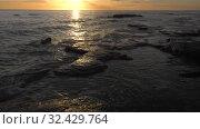 Купить «Каспийское море на закате. Волны набегают на скалистый берег. Caspian Sea at sunset. Waves run onto a rocky shore.», видеоролик № 32429764, снято 7 февраля 2019 г. (c) Евгений Романов / Фотобанк Лори
