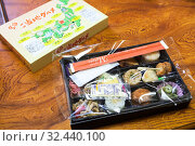 Set of Bento. It is a single-portion take-out or home-packed meal common in Japanese cuisine. Bento lunch boxes convenient for travel by train throughout Japan (2013 год). Редакционное фото, фотограф Кекяляйнен Андрей / Фотобанк Лори