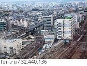 Купить «Railways lines pass to the Kyoto station. It is a major railway station and transportation hub in Kyoto. Aerial view at layout around with buildings of modern city. Киото, Япония», фото № 32440136, снято 12 апреля 2013 г. (c) Кекяляйнен Андрей / Фотобанк Лори