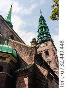 Lutheran St. Nicholas Church serving currently as Nikolaj Contemporary Art Center. Copenhagen, Denmark. Стоковое фото, фотограф Николай Коржов / Фотобанк Лори