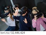 Купить «Enthusiastic children in virtual reality glasses in quest room», фото № 32446424, снято 21 октября 2017 г. (c) Яков Филимонов / Фотобанк Лори