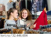 Купить «Two women choosing new blouse», фото № 32446604, снято 6 декабря 2018 г. (c) Яков Филимонов / Фотобанк Лори