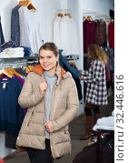 Woman standing in overcoat in boutique. Стоковое фото, фотограф Яков Филимонов / Фотобанк Лори