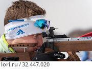 Купить «Close-up view sportsman biathlete aiming rifle shooting in prone position. Biathlete Mikhail Morilov in shooting range», фото № 32447020, снято 12 апреля 2019 г. (c) А. А. Пирагис / Фотобанк Лори