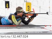Купить «Sportsman biathlete rifle shooting in prone position. Biathlete Khanzutin Artem in shooting range», фото № 32447024, снято 12 апреля 2019 г. (c) А. А. Пирагис / Фотобанк Лори