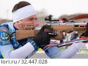 Купить «Close-up view sportsman biathlete aiming rifle shooting in prone position. Biathlete Krutov Andrey in shooting range», фото № 32447028, снято 12 апреля 2019 г. (c) А. А. Пирагис / Фотобанк Лори
