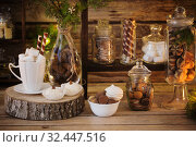 Купить «Christmas decoration cocoa bar with cookies and sweets on old wooden background in natural rustic style. Winter cozy concept», фото № 32447516, снято 16 ноября 2019 г. (c) Майя Крученкова / Фотобанк Лори
