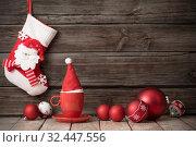 Купить «Christmas red and white decor on old wooden background», фото № 32447556, снято 18 ноября 2019 г. (c) Майя Крученкова / Фотобанк Лори