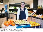 Купить «Shopping assistant demonstrating assortment of grocery shop», фото № 32455656, снято 23 ноября 2016 г. (c) Яков Филимонов / Фотобанк Лори
