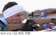 Купить «Sportsman biathlete aiming, rifle shooting and reloading rifle in prone position», видеоролик № 32455708, снято 12 апреля 2019 г. (c) А. А. Пирагис / Фотобанк Лори