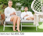 Купить «Couple relaxing in spa hotel outdoors», фото № 32455720, снято 24 апреля 2018 г. (c) Яков Филимонов / Фотобанк Лори