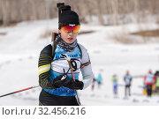 Купить «Korean sportswoman biathlete Lee Hyunju (South Korea) skiing in stadium of biathlon complex during Regional youth biathlon competitions East Cup», фото № 32456216, снято 13 апреля 2019 г. (c) А. А. Пирагис / Фотобанк Лори