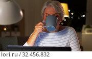 Купить «senior woman with laptop drinking coffee at home», видеоролик № 32456832, снято 18 ноября 2019 г. (c) Syda Productions / Фотобанк Лори