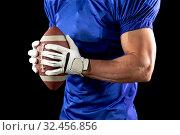Купить «American football player», фото № 32456856, снято 25 октября 2019 г. (c) Wavebreak Media / Фотобанк Лори