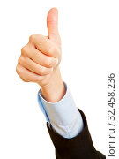 Hand hält den Daumen hoch zur Gratulation vom Sieg. Стоковое фото, фотограф Zoonar.com/Robert Kneschke / age Fotostock / Фотобанк Лори