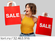 Купить «happy young woman with shopping bags on sale», фото № 32463916, снято 30 сентября 2019 г. (c) Syda Productions / Фотобанк Лори