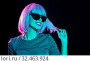 Купить «happy woman in pink wig and black sunglasses», фото № 32463924, снято 30 сентября 2019 г. (c) Syda Productions / Фотобанк Лори