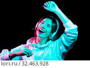 Купить «woman in headphones listening to music and dancing», фото № 32463928, снято 30 сентября 2019 г. (c) Syda Productions / Фотобанк Лори