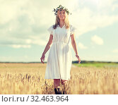 Купить «happy young woman in flower wreath on cereal field», фото № 32463964, снято 31 июля 2016 г. (c) Syda Productions / Фотобанк Лори