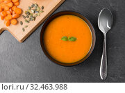 Купить «vegetable pumpkin cream soup in bowl with spoon», фото № 32463988, снято 5 апреля 2018 г. (c) Syda Productions / Фотобанк Лори