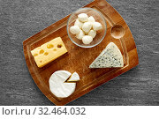 Купить «different kinds of cheese on wooden cutting board», фото № 32464032, снято 16 августа 2018 г. (c) Syda Productions / Фотобанк Лори