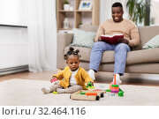 Купить «african baby girl playing with toy blocks at home», фото № 32464116, снято 29 сентября 2019 г. (c) Syda Productions / Фотобанк Лори
