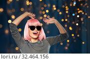 Купить «happy woman in pink wig and sunglasses dancing», фото № 32464156, снято 30 сентября 2019 г. (c) Syda Productions / Фотобанк Лори
