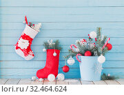 Купить «Christmas stocking and fir branches in blue buchet on blue woode», фото № 32464624, снято 14 ноября 2019 г. (c) Майя Крученкова / Фотобанк Лори