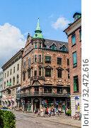 People walk by the Stroget street - the main shopping street of Copenhagen. Denmark, Europe. Редакционное фото, фотограф Николай Коржов / Фотобанк Лори